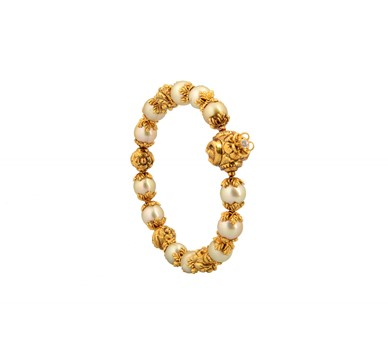 Gold Bangles with south sea Pearls